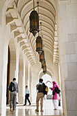 OMAN-Muscat-Al-Ghubrah: Grand Mosque-Arches and Lanterns with Visitors