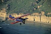 BiPlane over Torrey Pines State Beach, Northern San Diego Coastline, San Diego County, CALIFORNIA, USA