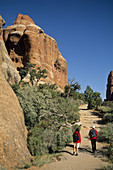 Hikers on the Devils Garden Trail Arches National Park, Utah, USA