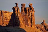 Sunrise light on the Three Gossips Arches National Park, Utah, USA
