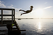 Bogo, Boy, Boys, Color, Colour, Contemporary, Denmark, Dive, Diving, Dock, Jump, Jumping, Lake, Pier, Play, Playing, Summer, Swim, Swimming, F57-661280, agefotostock
