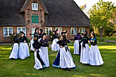 Dancing Group in traditional Costumes, Nebel, Amrum Island, North Frisian Islands, Schleswig-Holstein, Germany