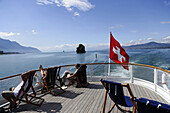 Passengers relaxing on an excursion boat, Canton of Vaud, Switzerland
