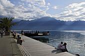 People sitting at promenade at Lake Geneva, Montreux, Canton of Vaud, Switzerland