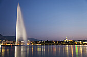 Illuminated Jet d'Eau, one of the largest fountains in the world, and St. Pierre Cathedral at night, Lake Geneva, Geneva, Canton of Geneva, Switzerland