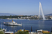 Excursion boat and Jet d'Eau, one of the largest fountains in the world, Lake Geneva, Geneva, Canton of Geneva, Switzerland