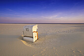Beach chair at Kniepsand beach in the evening sun, Amrum island, North Friesland, North Sea, Schleswig-Holstein, Germany