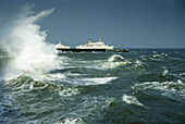 Waves at landing stage and ships on the sea, Helgoland island, North Friesland, North Sea, Schleswig-Holstein, Germany