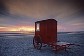Beach wagon at the beach at dusk, Borkum island, East Friesland, North Sea, Lower Saxony, Germany