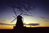 Windmill Nordermühle at sunset, Pellworm island, North Friesland, Schleswig-Holstein, Germany