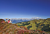 Hikers resting, Salzburg Slate Alps, Salzburg, Austria