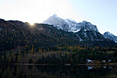 The lake Ferchensee in autumn in the shadow of the mountains, Werdenfelser Land, Bavaria, Germany