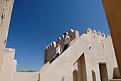 People visiting the Fort Jabrin on a sunny day, Fort Jabrin, Oman, Asia