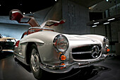 Mercedes Benz 300 SL Coupe, with gullwing doors, at Mercedes Benz Museum, Bad Cannstadt, Stuttgart, Baden-Wurttemberg, Germany