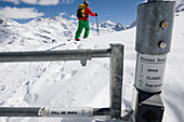 Domaine de Freeride, Zinal, A young man on skis passes an avalanche security gate, canton Valais, Wallis, Switzerland, Alps, MR