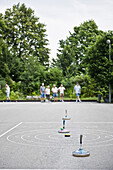 A small group of pensioners playing stock sport, Leisure activity, Park, Oberhaching, Bavaria, Germany