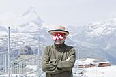 Mann wearing a sleeping mask, Mountain landscape, Valais, Switzerland