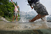 Young couple in lake Eibsee, Werdenfelser Land, Bavaria, Germany