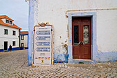 Direction sign placed outside a building, Historical, old fishing village of Ericeira, Portugal