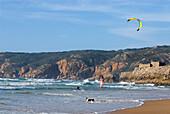 Kitesurfer and dog on Guincho Beach, Costa de Lisboa, Lisbon District, Estremadura, Portugal