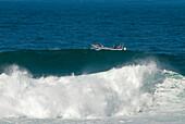 Fischermen in a boot near Guincho Beach, Costa de Lisboa, Lisbon District, Estremadura, Portugal