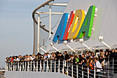 Passengers standing at the railing of cruise ship AidaDiva, Hamburg, Germany