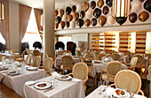 Tables are laid at  the deserted La Mer restaurant, Tides Hotel, Ocean Drive, South Beach, Miami Beach, Florida, USA
