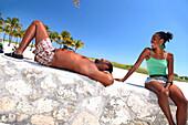 Laughing couple relaxing at Lummus Park, South Beach, Miami Beach, Florida, USA