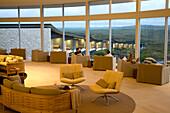 People sitting inside the cosy lounge of the Southern Ocean Lodge, Kangaroo Island, South Australia, Australia