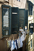 clothesline and window, typical Italian front, Italy
