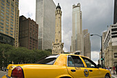 Taxi cab and Water Tower, Michigan Avenue, Chicago, Illinois, USA