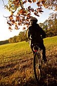 Woman alone outdoors on bicycle