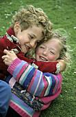 Children Playing in the Grass. Scottland, UK