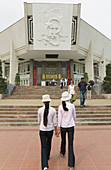 Two Vietnamese girls visiting the Ho Chi Minh Museum, Hanoi, Vietnam