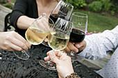 Chrysalis Vineyards, wine, glass, drink, smile, man, woman, toast. Middleburg. Virginia. USA.