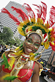 Canada, Montreal, Boulevard Rene Levesque, Mardi Gras style parade, costume, smiling Black teen girl, celebration
