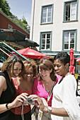 Canada, Quebec City, Lower Town, Boulevard Champlain, women smile, camera, Black female