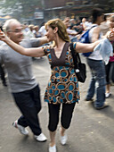 People dance in the street at a dance festival in Buenos Aires, Argentina