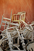 Atop a pile of chairs sits a yellow chair in the back room of the Bodie mortuary, CA, USA