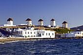 The windmills of Hora overlooking the Aegean Sea on the Greek Island of Mykonos, Greece.
