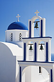 A traditional Greek blue domed church near Pyrgos on the Greek Island of Santorini, Greece.