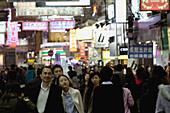 Crowded street in the night in Wanchai, Hong Kong Island, Hong Kong, VR China, East Asia