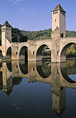The Pont-Valentré, a military engineering feat of the 14th century, has been classified as a world heritage site by UNESCO. Cahors is a historic city on an isthmus in a loop of the Lot river. Lot department. Midi-Pyrénées region. France.