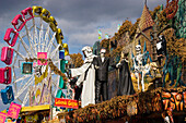 Ghost train and carrousel at Oktoberfest, Munich, Bavaria, Germany