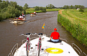 People in boats driving on the river Grecht, Netherlands, Europe