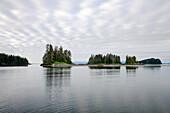 The remote Brothers Islands under cloudy sky, Inside Passage, Southeast Alaska, USA