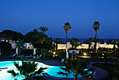 An illuminated pool and palm trees at night, Hammamet, Gouvernorat Nabeul, Tunisia, Africa