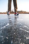 Ice skater on lake Ammersee, Upper Bavaria, Germany