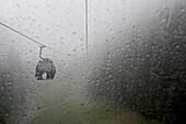 View through a wet window at a passenger cabin, Ischgl, Tyrol, Austria
