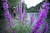 Mountainbiker having a rest at a river, Lillehammer, Norway